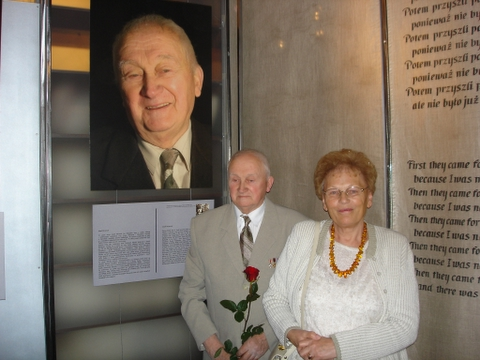 Righteous Jozef Mironiuk and his wife in front of his photo and story.